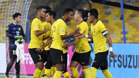 Timnas Malaysia saat merayakan gol ke gawang Laos. - INDOSPORT