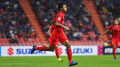 Indosport - Zulfiandi melakukan selebrasi usai cetak gol ke gawang Thailand