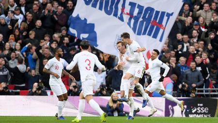 Harry Kane berselebrasi usai mencetak gol ke gawang Kroasia. - INDOSPORT
