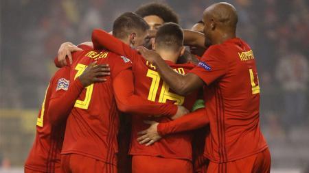 Para pemain Belgia melakukan selebrasi. - INDOSPORT
