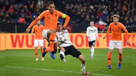 Gol Virgil van Dijk berhasil menyelamatkan Belanda dari kekalahan atas Jerman di UEFA Nations League, Selasa (20/11/18). - INDOSPORT