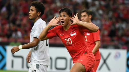 Striker Timnas Singapura, Ikhsan Fandi selebrasi - INDOSPORT
