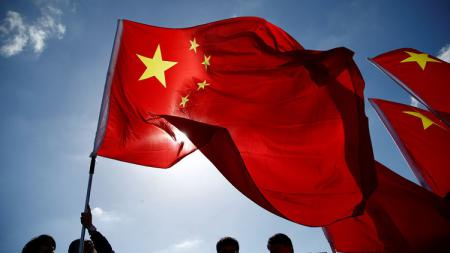 Pelari maraton China menolak membawa bendera China sampai akhirnya kalah. - INDOSPORT