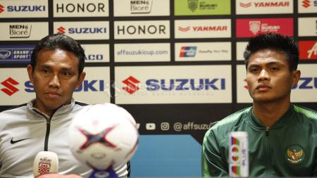 Bima Sakti dan Fachrudin Aryanto, pelatih dan bek Timnas Indonesia. - INDOSPORT