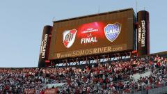 Indosport - Papan skor pertandingan final Copa Libertadores: River Plate vs Boca Juniors