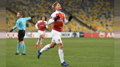 Indosport - Emile Smith Rowe merayakan gol saat partai Vorskla vs Arsenal di Liga Europa, Jumat (30/11/18).