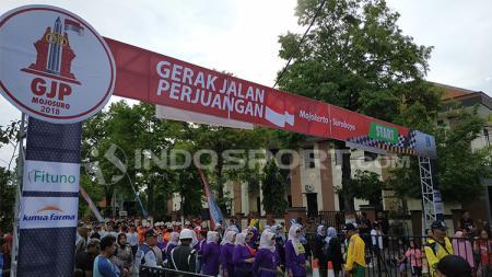 Aksi gerak jalan di Mojokerto-Surabaya. - INDOSPORT