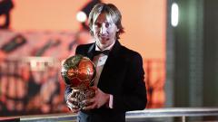 Indosport - Modric memenangkan Ballon d'Or 2018.