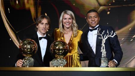 Gelandang Real Madrid, Luka Modric, berharap Kylian Mbappe agar meninggalkan Paris Saint-Germain (PSG). - INDOSPORT