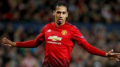 Indosport - Chris Smalling, bek tengah Manchester United.