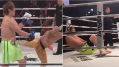 Indosport - Duel paling aneh antara Hong Man Choi vs Yi Long, dengan tinggi badan yang berbeda.
