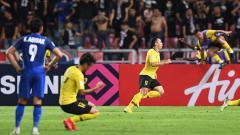 Indosport - Malaysia merayakan kelolosan ke babak final Piala AFF 2018.