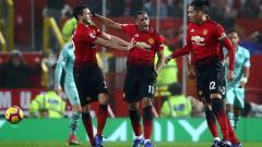 Indosport - Selebrasi Anthony Martial setelah mencetak gol pertama ke gawang Arsenal.