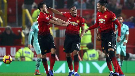 Selebrasi Anthony Martial setelah mencetak gol pertama ke gawang Arsenal. - INDOSPORT