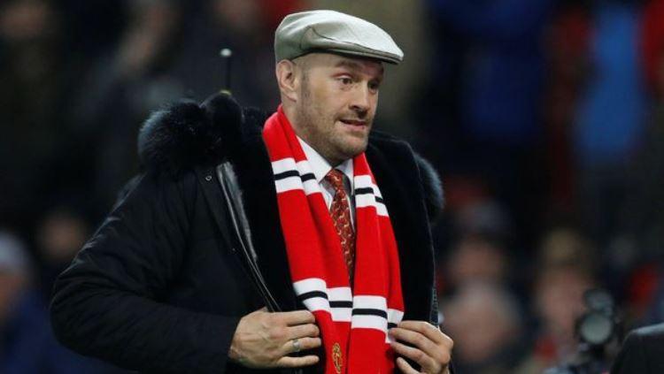 Tyson Fury terlihat di Old Trafford saat laga Manchester United vs Arsenal, Rabu (05/12/18) malam. Copyright: Reuters