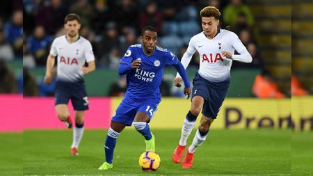 Dele Alli berusaha merebut bola dari pemain Leicester City - INDOSPORT