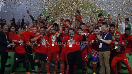 Pemain Persija Jakarta saat merayakan gelar juara Liga 1 2018. - INDOSPORT