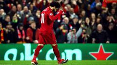 Indosport - Selebrasi bintang Liverpool, Mohamed Salah, saat melawan Napoli.