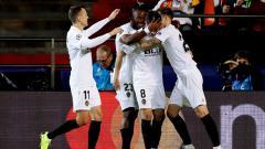 Indosport - Para pemain Valencia berselebrasi.