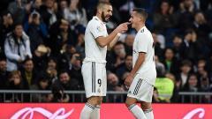 Indosport - Lucas Vazquez dan Benzema merayakan gol pertama ke gawang Rayo Vallecano.