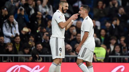 Lucas Vazquez dan Benzema merayakan gol pertama ke gawang Rayo Vallecano. - INDOSPORT