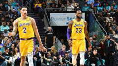 Indosport - 2 Bintang LA Lakers, LeBron James (kanan) dan Lonzo Ball.