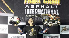 Indosport - Doni Tata Pradita saat menyabet juara umum TGA tahun 2017 dan 2018.