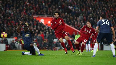 Shaqiri saat mencetak gol kedua utuk Liverpool di laga kontra Manchester United. - INDOSPORT