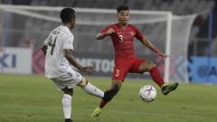 Indosport - Alfath Fathier saat membela Timnas Indonesia di Piala AFF 2018.
