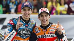 Indosport - Dua kakak beradik yang berkecimpung di dunia balap motor MotoGP dan Moto2, Marc dan Alex Marquez.