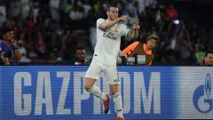 Indosport - Gareth Bale berselebrasi usai mencetak gol ke gawang Kashima Antlers.