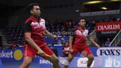 Indosport - Pasangan dari Pratama Badmimton Academy (Surabaya), Syahrizal Dafandi Arafixqli dan Syahrozi Dafandi Arafixqli dalam laga final Kejurnas Perorangan Taruna PBSI 2018.