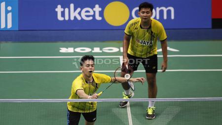 Pasangan klub Jaya Raya, Angga Pratama/Muhammad Rian Ardianto saat tampil pada babak final Kejurnas Beregu Campuran PBSI 2018. - INDOSPORT