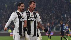 Indosport - Mario Mandzukic berselebrasi usai mencetak gol ke gawang AS Roma.