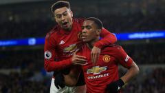Indosport - Pemain Manchester United, Jesse Lingard dan Anthony Martial.