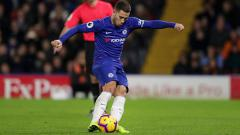 Indosport - Eden Hazard saat mengeksekusi penalti.