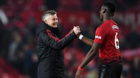 Pelatih Manchester United, Ole Gunnar Solskjaer, ancam naikkan harga Paul Pogba jika benar ingin hengkang dari klub. - INDOSPORT