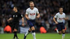 Indosport - Harry Kane berselebrasi usai mencetak gol ke gawang Wolves.