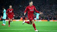 Indosport - Roberto Firmino berselebrasi usai mencetak gol.