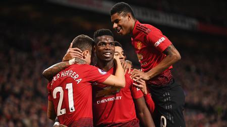 Paul Pogba berselebrasi usai berhasil mencetak gol ke gawang Bournemouth. - INDOSPORT
