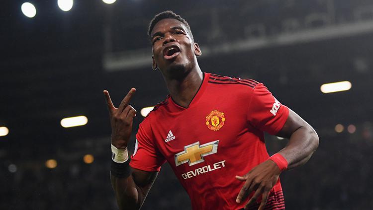 Paul Pogba berselebrasi usai berhasil mencetak gol ke gawang Bournemouth. Copyright: Getty Images