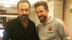 Indosport - Fabio Lopez berfoto bersama pelatih AS Roma saat ini, Eusebio di Francesco