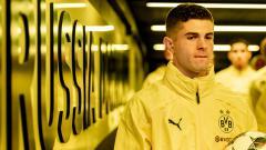 Indosport - Christian Pulisic saat masih berseragam Borussia Dortmund, yang kini sudah tergantikan oleh tiga pemain baru.