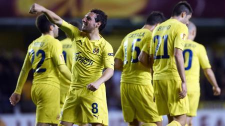 Santi Cazorla merayakan gol yang diciptakannya ke gawang Real Madrid. - INDOSPORT