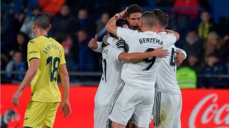 Skuat Real Madrid merayakan gol yang dicetak ke gawang Villarreal. - INDOSPORT