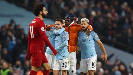 Liverpool dan Manchester City hanya berselisih 4 poin di klasemen sementara. - INDOSPORT