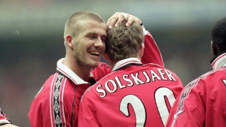 David Beckham dan Ole Gunnar Solskjaer saat masih menjadi pemain Manchester United. - INDOSPORT