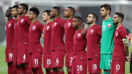 Timnas Qatar kala melawan Palstina di laga persahabatan. - INDOSPORT