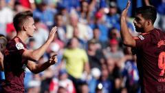Indosport - Denis Suarez (kiri) dan Luis Suarez