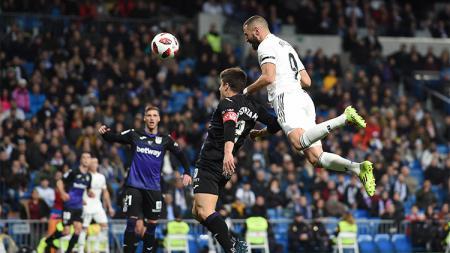 Karim Benzema berduel udara dengan pemain Leganes - INDOSPORT